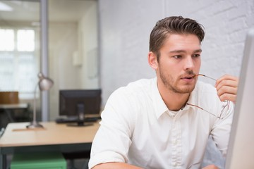 Businessman looking at computer in office