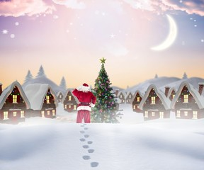 Composite image of santa walking in the snow