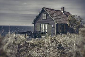 Seaside cottage at dusk