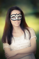 Young Woman in White Dress Wearing Mask