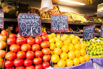 Orange and tomatoes at fruit market