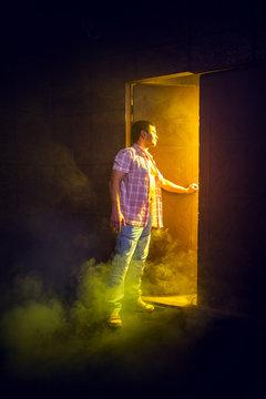 Man opens the door to light room