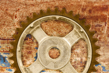 Vintage cog wheel against a rusty background