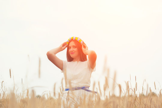 beautiful young woman wearing blue and yellow wreath and posing