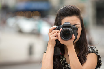 Young Asian Woman taking photo with camera