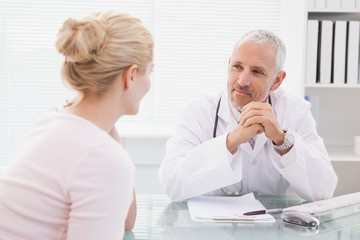 Patient consulting a happy doctor