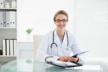 Doctor holding her tablet pc