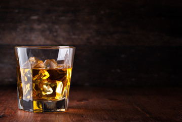 Acrylic Prints Bar Glass of scotch whiskey and ice