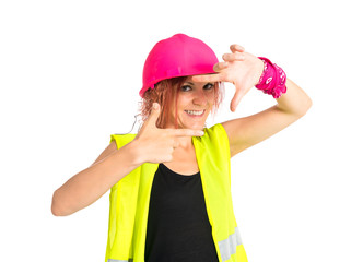 Worker woman focusing with her fingers on a white background