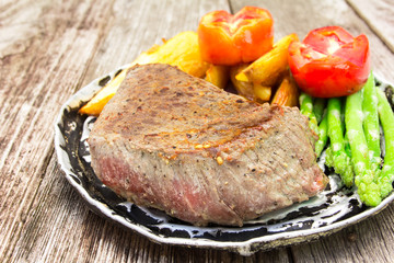 grilled fillet steak served with tomatoes and roast vegetables o