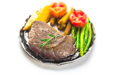 grilled fillet steak served with tomatoes and roast vegetables