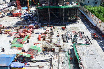 People working on Building Business Construction Site at Bangkok