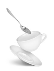 falling cup with saucer and spoon on isolated white background