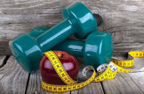 Measuring tape wrapped around a apple weight loss photo