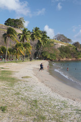 Beach at fortress walls. Fort-de-France, Martinique