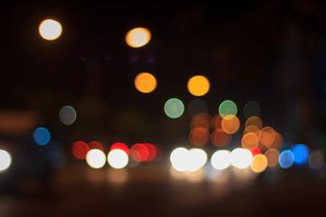 Bokeh blur of car lights on street at night.