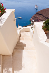 The stairs leading to the port in Oia town. Santorini, Greece.