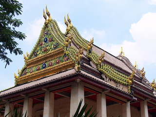 The ceramic decorated at roof parts of temple in Thailand.