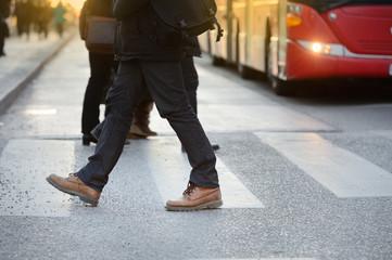 Man, bus and zebra crossing
