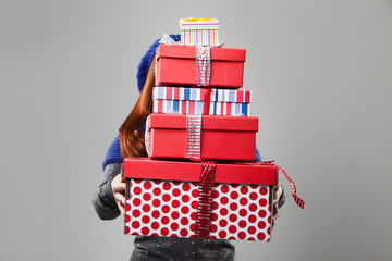 Woman Covered by Carried Gift Boxes
