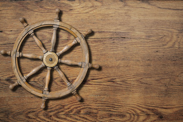 Steering wheel over wood background