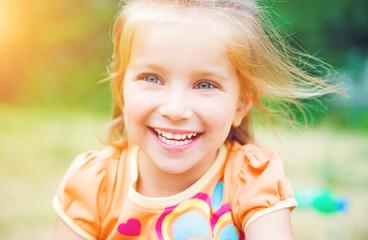 Cute little girl  on the meadow