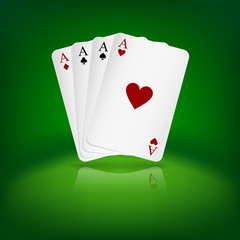 Four aces playing cards on green background.