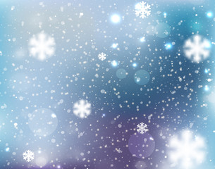 Winter blurred bokeh background with glowing snowflakes.Great