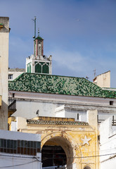 Wall Mural - Street view with traditional colorful houses. Tangier, Morocco