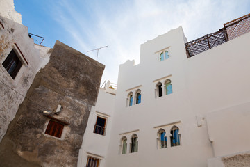 Walls, small windows and blue sky. Medina, old part of Tangier,