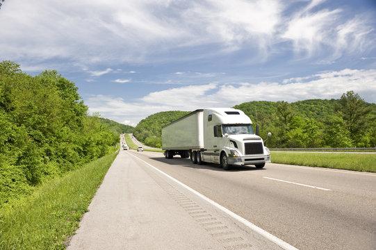 White Semi Truck On Highway In Springtime