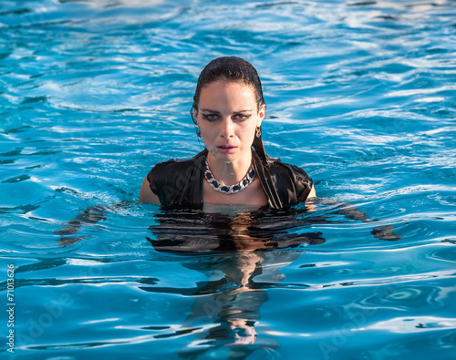 8a7bfe9af27c5 wet woman in black dress in a swimming pool