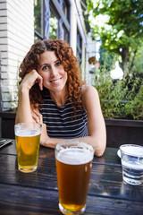 smiling woman having beer