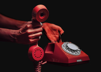 Devil hands giving vintage phone