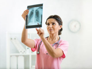 doctor reviewing x-ray photo in office