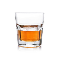 Glass of whisky on a white background.