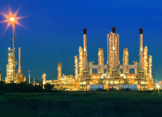 lighting of oil refinery palnt against dusky blue sky of oil re