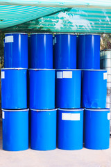 Some blue barrels under a green canopy