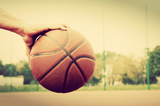 Dribbling with basketball ball. Vintage style