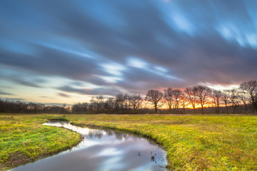 Wall Mural - Long Exposure Sunset over River Landscape