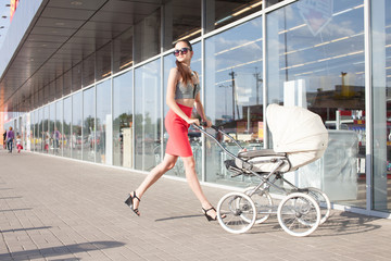 Running Trendy mother and baby in stroller