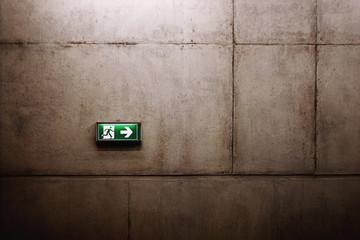 green exit sign on the wall Wall mural