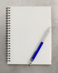 checked notebook at metal background