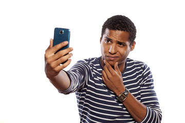 dark-skinned young man making selfie on white background