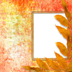 Bright autumn leaves on the abstract scratch background