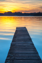Wall Mural - Beautiful Sunset over Wooden Jetty in Groningen, Netherlands