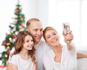 happy family with camera at home