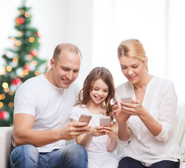 happy family with smartphones