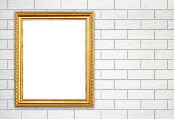 blank golden frame on brick stone wall