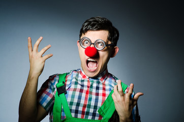 Wall Mural - Funny clown against the grey background
